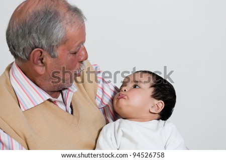 portrait of happy grandfather and grand daughter, grandfather and grandchild - stock photo