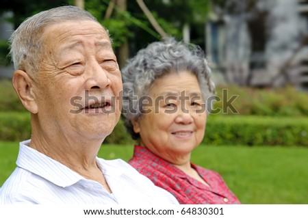 portrait of happy grandfather and grandmother - stock photo