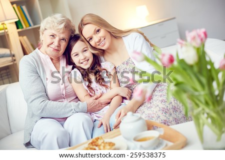 Portrait of happy grandma, mother and daughter - stock photo