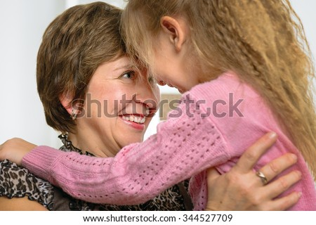 Portrait of happy grandmother and granddaughter - stock photo