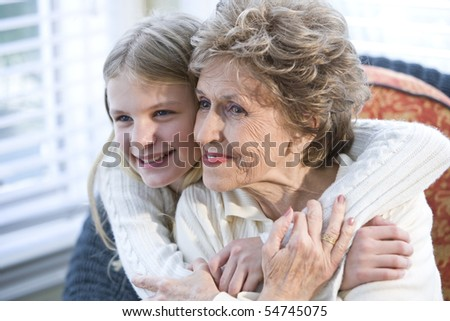Portrait of happy grandmother with grandchild hugging - stock photo