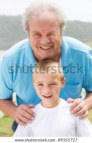 portrait of happy grandpa and grandson outdoors - stock photo