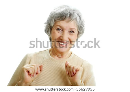 Portrait of happy grey haired woman looking at camera - stock photo