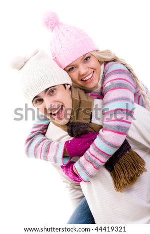 Portrait of happy guy holding glad female on his back