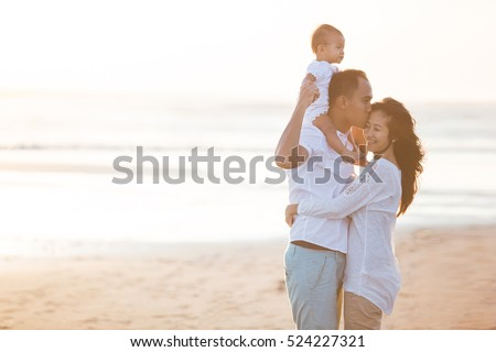 portrait of happy happy family at the beach loving and embracing