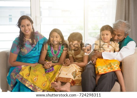 Portrait of happy Indian family at home. Asian people indoors lifestyle.