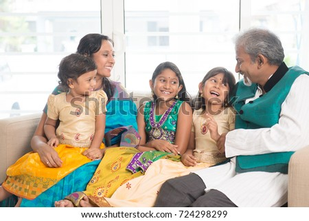 Portrait of happy Indian family bonding at home. Asian people indoors lifestyle.