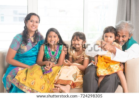 Portrait of happy Indian family of five at home. Asian people indoors lifestyle.