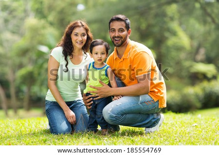 portrait of happy indian family outdoors - stock photo