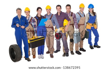 Portrait of happy industrial workers. Isolated on white - stock photo