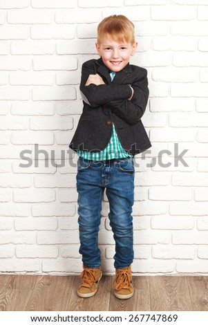 Portrait of happy joyful beautiful little boy in a jacket - stock photo