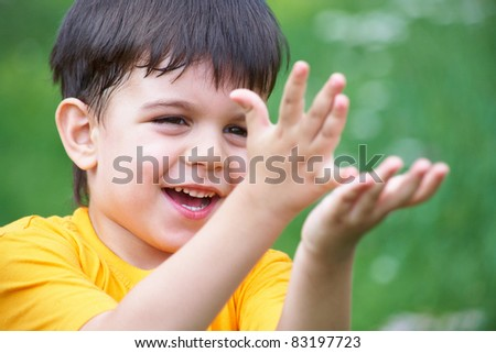 Portrait of happy joyful beautiful little boy in summertime - stock photo