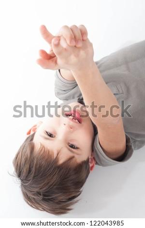 Portrait of happy joyful beautiful little boy isolated on white background - stock photo