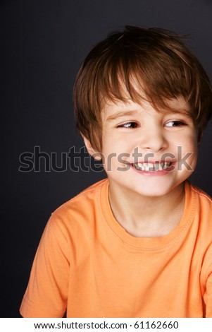 Portrait of happy joyful beautiful little boy, studio shot - stock photo