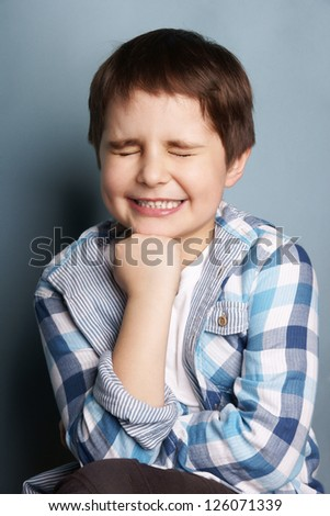 Portrait of happy joyful little boy, studio shot - stock photo