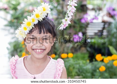 Portrait of happy joyful smiling beautiful little asian kid - stock photo