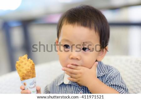 Portrait of happy kid with ice-cream cone - stock photo