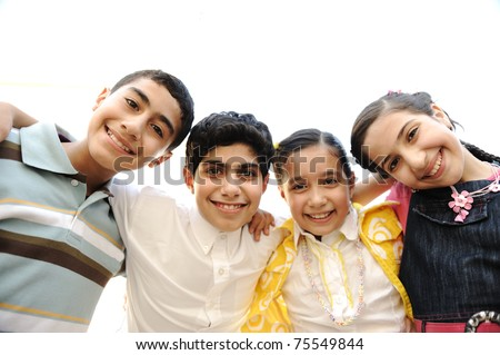 Portrait of happy kids outdoor looking at camera - stock photo