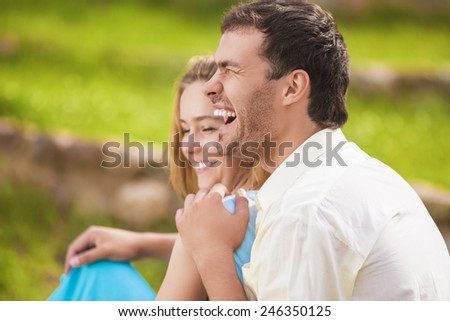 Portrait of Happy Laughing Caucasian Couple Having Fun Outdoors and Embracing. Horizontal Image - stock photo