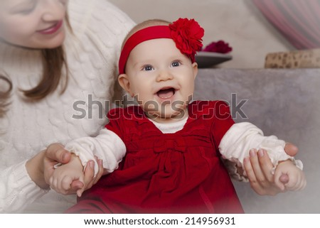 Portrait of happy little baby five months of my mother on the handles, Christmas, holidays - stock photo