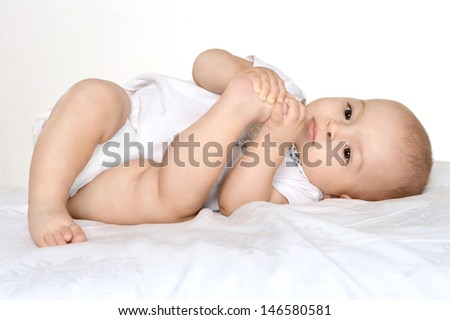 portrait of happy little baby on a light background