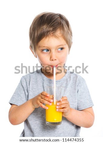 Portrait of happy little boy drinking orange juice. Isolated over white background. - stock photo