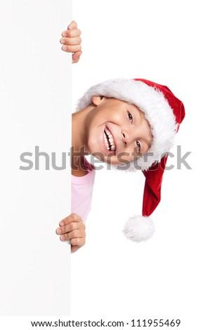 Portrait of happy little boy in Santa hat with white blank - stock photo