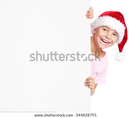 Portrait of happy little boy in Santa hat with white blank - stock photo