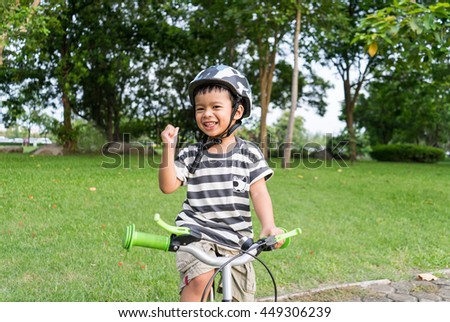 Portrait of happy little boy on bicycle