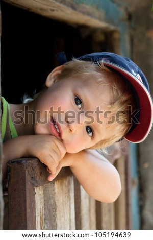 Portrait of happy little boy. outdoors - stock photo