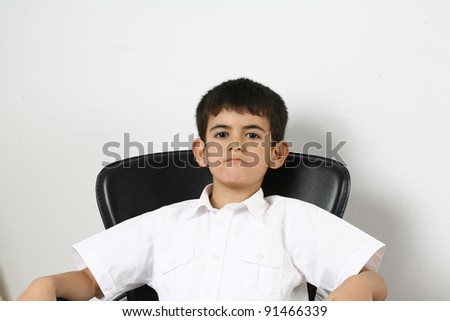 Portrait of happy little boy over white background - stock photo
