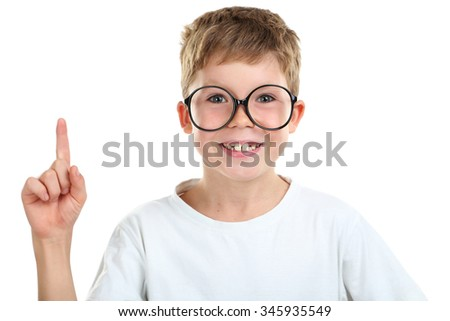 Portrait of happy little boy with eyeglasses on white background - stock photo