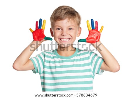 Portrait of happy little boy with paints on hands isolated on white background - stock photo