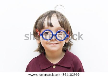Portrait of Happy Little Boys Wearing Eyeglasses Indoors - stock photo