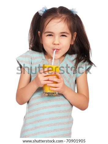 Portrait of happy little girl drinking orange juice - stock photo