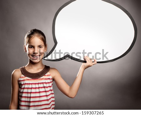 portrait of happy little girl holding a speech bubble - stock photo