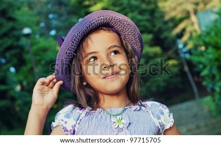 Portrait of  happy little girl in a summer day - stock photo