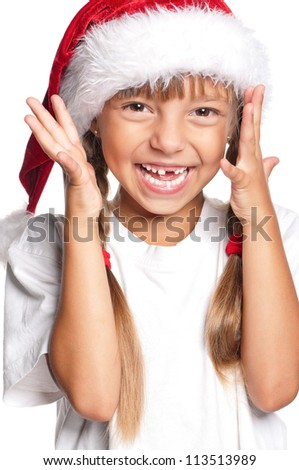 Portrait of happy little girl in Santa hat isolated on white background - stock photo