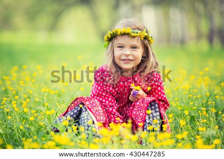 Portrait of happy little girl in spring park - stock photo