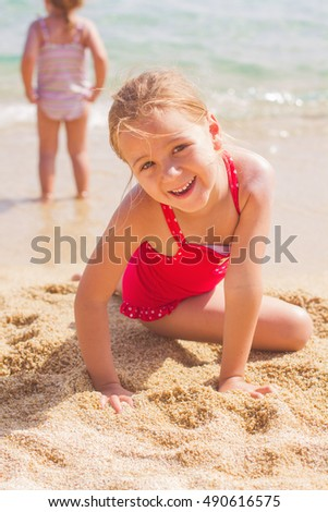 Portrait of Happy Little Girl on the sandy beach. Summer vacation.