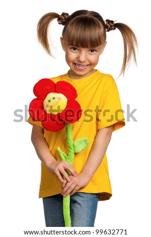 Portrait of happy little girl with flower isolated on white background - stock photo