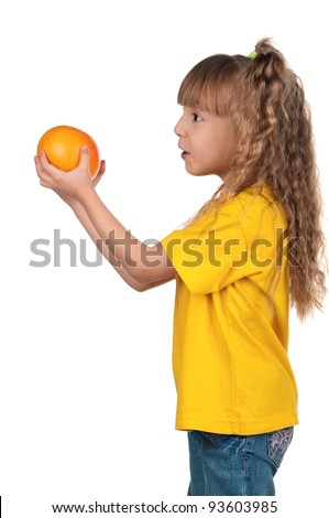 Portrait of happy little girl with grapefruit over white background