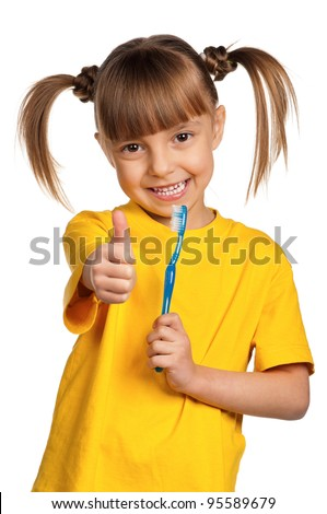 Portrait of happy little girl with tooth brush isolated on white background - stock photo