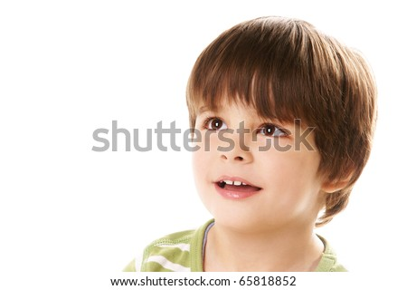 Portrait of happy little smiling boy looking up on white background - stock photo