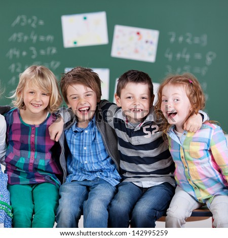 Portrait of happy little students during the break time in school - stock photo