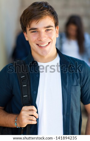portrait of happy male high school student smiling - stock photo