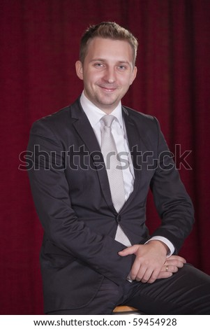 portrait of happy male performer on the stage - stock photo