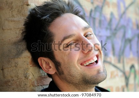 Portrait of happy man in urban background