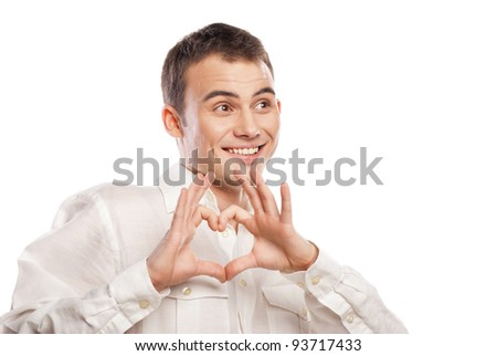 Portrait of happy man making heart from his hands on white background - stock photo