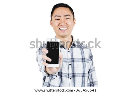 Portrait of happy man showing smart phone while standing against white background